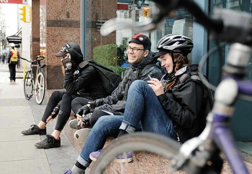 Bike messenger's gather in the centre of Vancouver waiting for the next delivery.